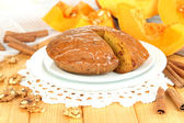 Delicious pumpkin pie on plate on wooden table close-up — Stock Photo