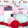 Stock Photo: Cosmetics and bath accessories on mosaic tiles background