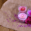 Composition with beautiful colorful candles, sea salt and orchid flowers, on wooden background — Stock Photo #39280885