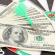 Dart on dartboard and money close up. Concept of success. — Stock Photo #39281061