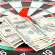Dart on dartboard and money close up. Concept of success. — Stock Photo #39281063