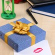 Gift with card for loved one on desktop close-up — Stock Photo #39281225