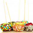 Stock Photo: Candied apples on sticks on wooden table on white background