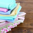 Kitchen towels on wooden background — Stock Photo #39281939
