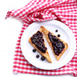 Delicious toast with jam on plate isolated on white — Stock Photo