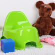 Stock Photo: Green potty on home interior background