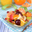 Sweet fresh fruits in bowl on table close-up — Stock Photo