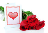 Beautiful red roses with card isolated on white — Stock Photo