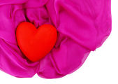 Decorative red heart, on color fabric, isolated on white — ストック写真