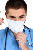 Young male doctor in medical mask, isolated on white — Stock Photo
