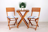Garden chairs and table on white background — Stock Photo