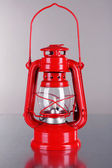Red kerosene lamp on grey background — Stock Photo