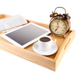 Tablet, newspaper, cup of coffee and alarm clock on wooden tray, isolated on white — Stock Photo