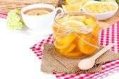 Geléia de limão saboroso com uma xícara de chá em close-up tabela — Foto Stock