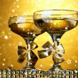 Two glasses of champagne on bright background with lights — Stock Photo #39432411