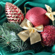 Beautiful Christmas decor on green satin cloth — Stock Photo #39433217