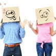 Couple with cardboard boxes on their heads isolated on white — Stock Photo #39433967
