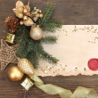 Frame with vintage paper and Christmas decorations on wooden background — Stock fotografie