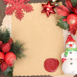Frame with vintage paper and Christmas decorations on wooden background — 图库照片 #39434181