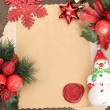 Frame with vintage paper and Christmas decorations on wooden background — 图库照片