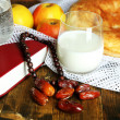 Stock Photo: Composition with traditional Ramadfood, holy book and rosary, on wooden background
