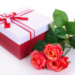Beautiful gift box with flowers isolated on white — Stock Photo #39434633
