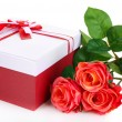 Beautiful gift box with flowers isolated on white — Stock Photo #39434637