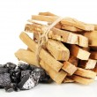Stock Photo: Stack of firewood and heap of coal isolated on white