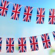 Garland of flags on bright background — Stock Photo #39435059