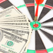 Dart on dartboard and money close up. Concept of success. — Stock Photo #39435167