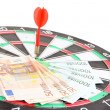 Stock Photo: Dart on dartboard and money close up. Concept of success.