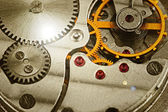 Clockwork details, pinions and wheels closeup — Stock Photo