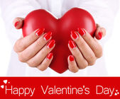 Red heart in woman hands close up — Foto Stock