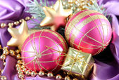 Beautiful Christmas decor on purple satin cloth — Photo
