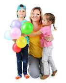 Little children with nice mom isolated on white — Stock Photo