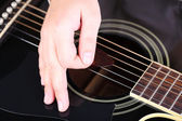Acoustic guitar in female hands, close-up — Stock Photo