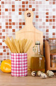 Cooking food in kitchen on table on mosaic tiles background — Stock Photo