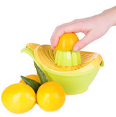 Preparing fresh lemon juice squeezed with hand juicer isolated on white — Stock Photo