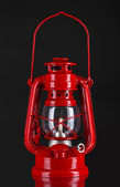 Red kerosene lamp on black background — Stock Photo