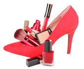 Beautiful red female shoe with cosmetics, isolated on white — Stock Photo