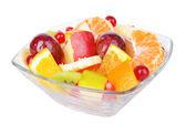 Sweet fresh fruits in bowl isolated on white — Stock fotografie