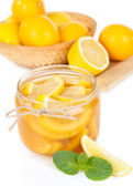 Tasty lemon jam isolated on white — Stock Photo