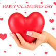Red heart in woman's hand, on white background close-up — Stock Photo