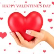 Red heart in woman's hand, on white background close-up — Stock Photo #39499667
