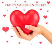 красное сердце в руке женщины, на белом фоне крупным планом — Стоковое фото