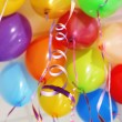 Many bright balloons under ceiling close-up — Stock Photo #39500005