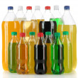Stock Photo: Assortment of bottles with tasty drinks, isolated on white