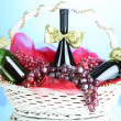 Gift basket with wine on blue background — Stock Photo #39500583
