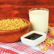 Soy products on table on wooden background — Foto Stock