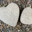 Two hearts on small sea stones, close up — Stock Photo #39501297